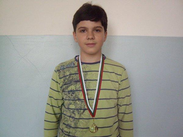 захари - медал олимпиада